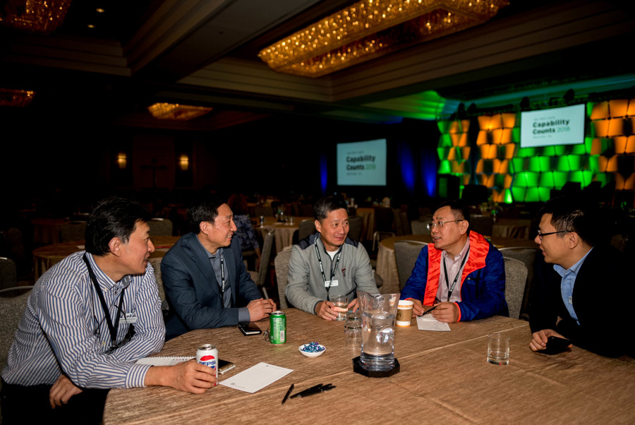 Capability Counts 2018 attendees networking in the main ballroom